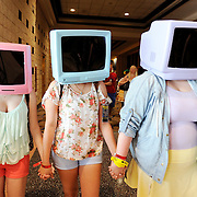 "Dressed as the character ""T.V. Heads"", from left, Katie Hartley-Hahn, Emilee Mayer, center, and Morgan North, all from Jensen Beach, FL walk through the halls during the first day of Metrocon inside the Tampa Convention Center Friday, July 11, 2014 in Tampa. The annual event is billed as Florida's largest anime convention and will run through Sunday."