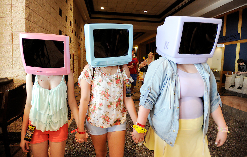 """Dressed as the character """"T.V. Heads"""", from left, Katie Hartley-Hahn, Emilee Mayer, center, and Morgan North, all from Jensen Beach, FL walk through the halls during the first day of Metrocon inside the Tampa Convention Center Friday, July 11, 2014 in Tampa. The annual event is billed as Florida's largest anime convention and will run through Sunday."""