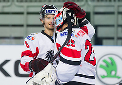 Raphael Herburger of Austria and Bernhard Starkbaum of Austria celebrate after the ice-hockey match between Austria and Great Britain at IIHF World Championship DIV. I Group A Slovenia 2012, on April 16, 2012 in Arena Stozice, Ljubljana, Slovenia. Austria defeated Great Britain 6-3. (Photo by Vid Ponikvar / Sportida.com)