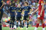 Arsenal forward Nicolas Pepe (19), Arsenal forward Pierre-Emerick Aubameyang (14) and Arsenal defender David Luiz (23) eye up the free kick during the Premier League match between Liverpool and Arsenal at Anfield, Liverpool, England on 24 August 2019.
