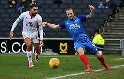 Jack Marriott of Peterborough United keeps the ball in play as Scott Golbourne of Milton Keynes Dons watches on - Mandatory by-line: Joe Dent/JMP - 30/12/2017 - FOOTBALL - Stadium MK - Milton Keynes, England - Milton Keynes Dons v Peterborough United - Sky Bet League One