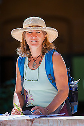 North America, Mexico, San Miguel de Allende, woman wearing sun hat with map.  MR