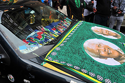 JOHANNESBURG, SOUTH AFRICA – APRIL 07: A car a draped with South African flags and a flag with the face of the late Nelson Mandela as MKMVA, ANCYL and ANC members gather outside Luthuli House in support of the ANC and Zuma amidst calls for President Zuma to step down, in Johannesburg, South Africa, 07 April 2017. Businesses closed and South Africans from numerous political, religious, labour and civic groups gathered at central points across the entire country protesting against President Zuma's recent government reshuffle appointing 10 new ministers and 10 new deputy ministers including the axing of the finance minister. Photo: Dino Lloyd