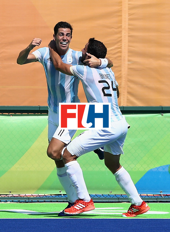 RIO DE JANEIRO, BRAZIL - AUGUST 16:  Joaquin Menini (L) of Argentina celebrates with team mate Manuel Brunet after scoring their fifth goal during the Men's semi final hockey match between Argentina and Germany on Day 11 of the Rio 2016 Olympic Games held at the Olympic Hockey Centre on August 16, 2016 in Rio de Janeiro, Brazil.  (Photo by David Rogers/Getty Images)