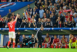 LILLE, FRANCE - Friday, July 1, 2016: Wales staff celebrate the second goal, scored by Hal Robson-Kanu, against Belgium during the UEFA Euro 2016 Championship Quarter-Final match at the Stade Pierre Mauroy. head of performance Ryland Morgans, physiotherapist David Weeks, physiotherapist Paul Harris, Jamie Benito Plans, Mike Murphy, Kevin McCusker, head of international affairs Mark Evans, team operations manager Amanda Smith, masseur Chris Senior. (Pic by David Rawcliffe/Propaganda)