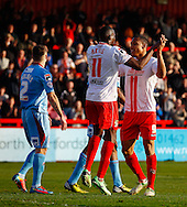 Darius Charles of Stevenage (right)  celebrates scoring his team's second goal to make it 2-0 with Lucas Akins of Stevenage (centre) during the Sky Bet League 1 match at the Lamex Stadium, Stevenage<br /> Picture by David Horn/Focus Images Ltd +44 7545 970036<br /> 08/03/2014
