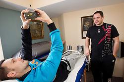 Luka Zvizej and physiotherapist Sokol Kadrija during visit in the rooms of Slovenia Men Handball team during 5th day of 10th EHF European Handball Championship Serbia 2012, on January 19, 2012 in Hotel Srbija, Vrsac, Serbia.  (Photo By Vid Ponikvar / Sportida.com)