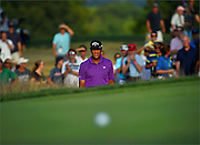 Tony FInau watches his ball roll down the green during the third round of The Barclays Championship held at Plainfield Country Club in Edison, New Jersey on August 29.