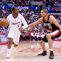 12 February 2014: Los Angeles Clippers point guard Chris Paul (3) drives past Portland Trail Blazers small forward Nicolas Batum (88) during the Los Angeles Clippers 122-117 victory over the Portland Trail Blazers at the Staples Center, Los Angeles, California, USA.