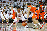 FAYETTEVILLE, AR - NOVEMBER 30:  DeQuavious Wagner #23 of the Arkansas Razorbacks defends Brandon Triche #20 of the Syracuse Orangemen at Bud Walton Arena on November 30, 2012 in Fayetteville, Arkansas.  The Orangemen defeated the Razorbacks 91-82.  (Photo by Wesley Hitt/Getty Images) *** Local Caption *** DeQuavious Wagner; Brandon Triche