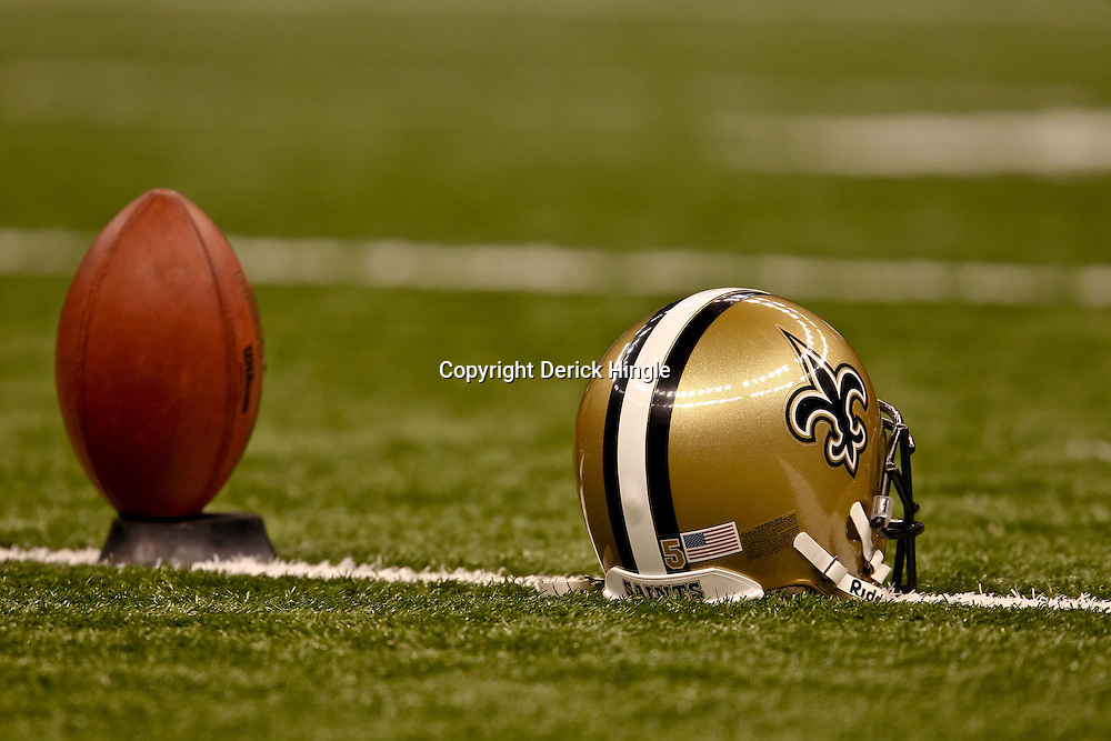 November 21, 2010; New Orleans, LA, USA; The helmet of New Orleans Saints place kicker Garrett Hartley (5) and a football on a kicking tee is seen during warm ups prior to kickoff of a game against the Seattle Seahawks at the Louisiana Superdome. Mandatory Credit: Derick E. Hingle