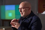 Brian Eno, musician in his studio, London.