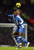 Photo: Chris Ratcliffe.<br />West Ham United v Wigan Athletic. The Barclays Premiership. 28/12/2005.<br />Anton Ferdinand (R) of West Ham beats Jason Roberts to this aerial ball.