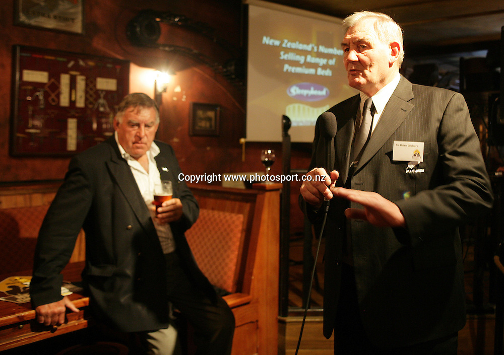 Sir Brian Lochore speaks with Colin Meads behind at the launch of the AA Rewards Heartland Championship at the Muddy Farmer Pub, Auckland, New Zealand on Friday 18 August, 2006. Photo: Hannah Johnston/PHOTOSPORT<br />