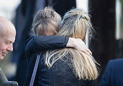 © Licensed to London News Pictures. 27/02/2017. Dummer, UK. Mourners comfort each other after attending a memorial service for Tara Palmer Tomkinson at All Saints' Church in Dummer, Hampshire.  Tara, 45, was found dead in her home in south west London on February 8. Her older sister said that 'Tara Clare died peacefully in her sleep on February 8th 2017. Photo credit: Peter Macdiarmid/LNP