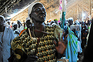 A woman sings during a Sunday morning church service.<br /> Yei, Southern Sudan. 26/06/2011.