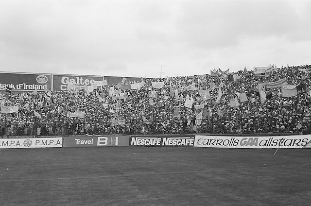 Excited fans along Hill 16 waving flags during the All Ireland Senior Gaelic Football Final, Kerry v Dublin in Croke Park on the 28th September 1975. Kerry 2-12 Dublin 0-11.