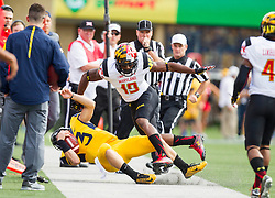 Sep 26, 2015; Morgantown, WV, USA; West Virginia Mountaineers quarterback Skyler Howard is hit by Maryland Terriapins defensive back A.J. Hendy during the first quarter at Milan Puskar Stadium. Mandatory Credit: Ben Queen-USA TODAY Sports