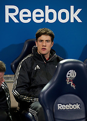 BOLTON, ENGLAND - Saturday, January 21, 2011: Liverpool's substitute Martin Kelly sits on the bench before the Premiership match against Bolton Wanderers at the Reebok Stadium. (Pic by David Rawcliffe/Propaganda)
