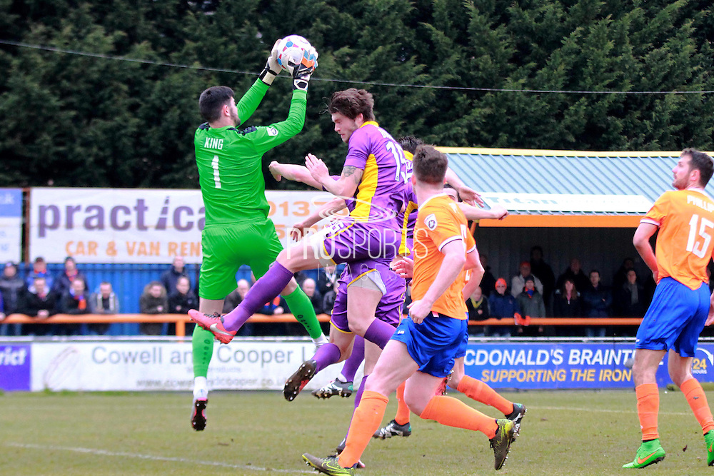 Cameron Burgess has his shot saved by Tom King during the Vanarama National League match between Braintree Town and Cheltenham Town at the Amlin Stadium, Braintree, United Kingdom on 19 March 2016. Photo by Carl Hewlett
