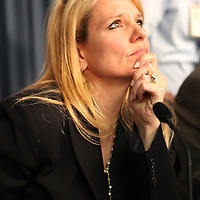 SpaceX President Gwynne Shotwell listens to questions from the media after the Falcon 9 rocket test launch was delayed at Cape Canaveral's Complex 40 launch pad after cracks were discovered on a nozzle on December 6, 2010 at Cape Canaveral, Florida. (AP Photo/Alex Menendez)