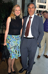 JOHN REDWOOD and NIKKI PAGE at the Conservative party Pre-Conference Season party hosted by Lord Saatchi and Lord Strathclyde and held at M&C Saatchi, 36 Golden Square, London W1 on 7th September 2004.