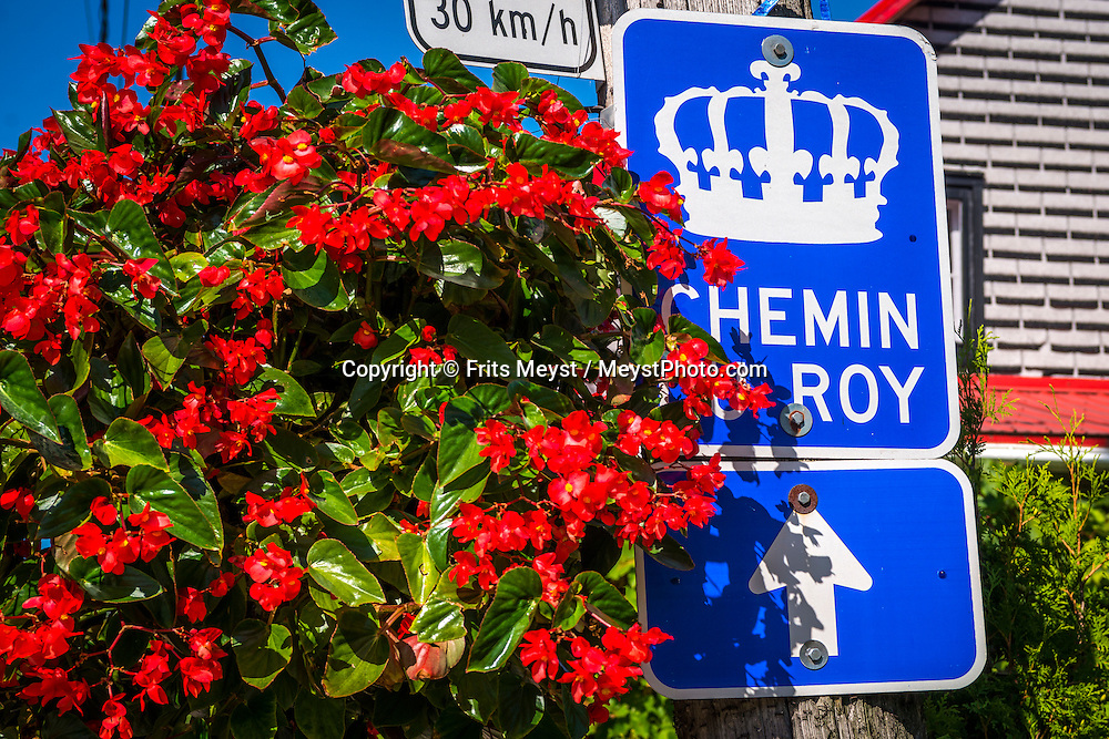 Quebec, Canada, August 2014. Chemin du Roy Scenic drive passes cafe the la place La Barberie . Quebec province is unique among North American tourist destinations. Its French heritage does not only set the province apart from most of its English speaking neighbors, it is also one of the few historical areas in North America to have fully preserved its Francophone culture. Its European feel and its history, culture and warmth have made Quebec a favourite tourist destination both nationally and internationally. Photo by Frits Meyst / MeystPhoto.com