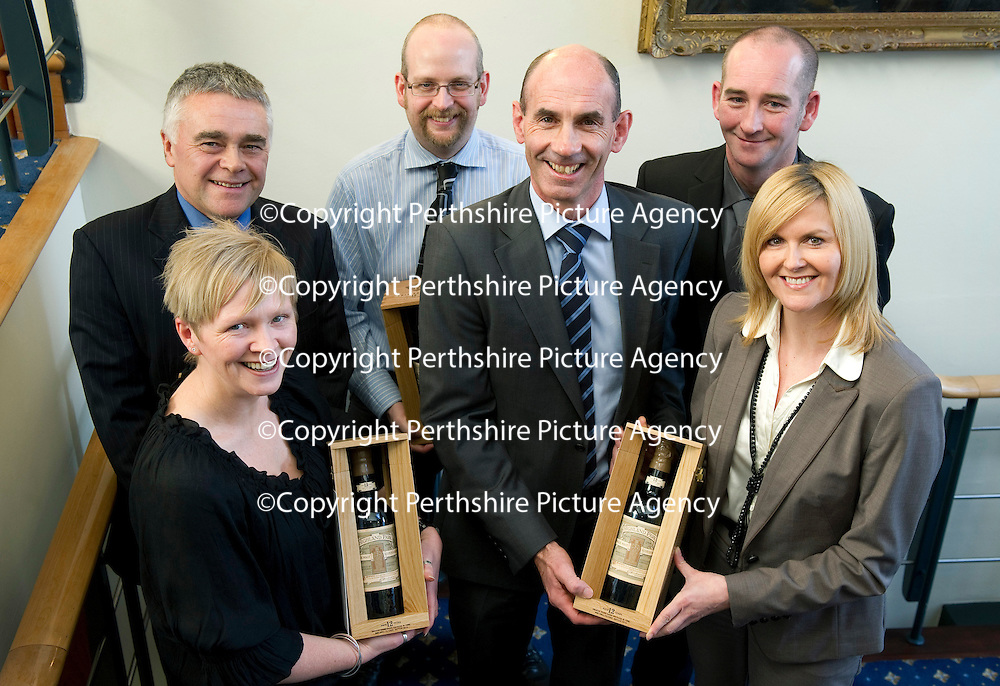 Edrington Achievement Awards....15.12.11<br /> Chief Exec Ian Curle with the runner-up from left, Julie Baker, Max McFarlane, Andy Clist, Andy Donnelly and Lorna McDougall.<br /> Picture by Graeme Hart.<br /> Copyright Perthshire Picture Agency<br /> Tel: 01738 623350  Mobile: 07990 594431