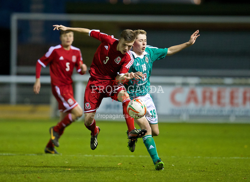 BANGOR, WALES - Thursday, November 21, 2013: Wales' Rhys Abbruzzese (Cardiff City - Aberdare High School) in action against Northern Ireland's Kyle Walker during the Victory Shield match at Nantporth Stadium. (Pic by David Rawcliffe/Propaganda)