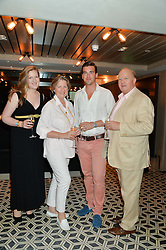 Left to right, CLAUDIA CONWAY, COLLETE CONWAY, DEREK CONWAY and FREDDIE CONWAY at Henry Conway's 31st birthday party held at the Pont St Restaurant, Belgraves Hotel, London on 12th July 2014.