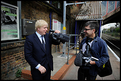London Mayor Boris Johnson at the train station during the Mayoral Campaign, London, UK, April 13, 2012. Photo By Andrew Parsons / i-Images.