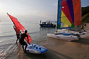 Ao Phrao Resort. New guests arriving amidst watersport activities.