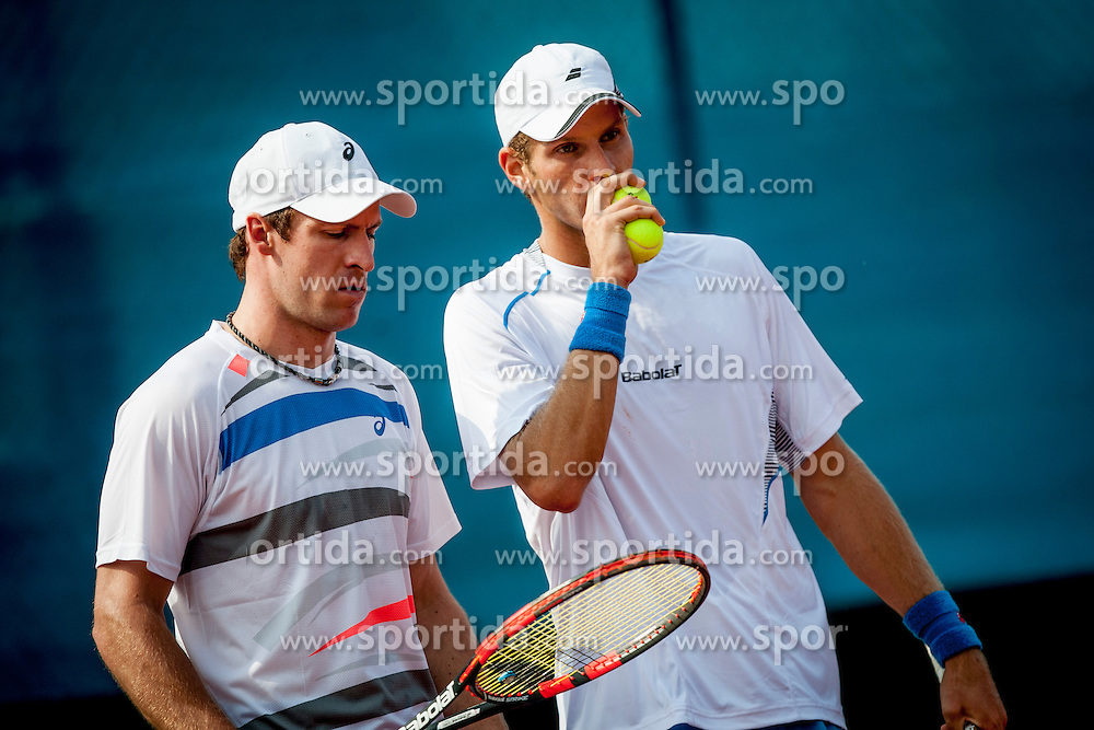 Blaz Rola and Grega Zemlja of Slovenia (with cap) play against Jonathan Erlich and Andy Ram of Israel (without cap) during 3rd match of Davis cup Slovenia vs. Israel on April 6, 2014 in Portoroz, Slovenia. Photo by Urban Urbanc / Sportida