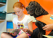 Amelia Trabachino, 8 reads to Roxy the Reading Dog at Gayman Elementary School Friday June 12, 2015 in Doylestown, Pennsylvania.  (Photo by William Thomas Cain/Cain Images)