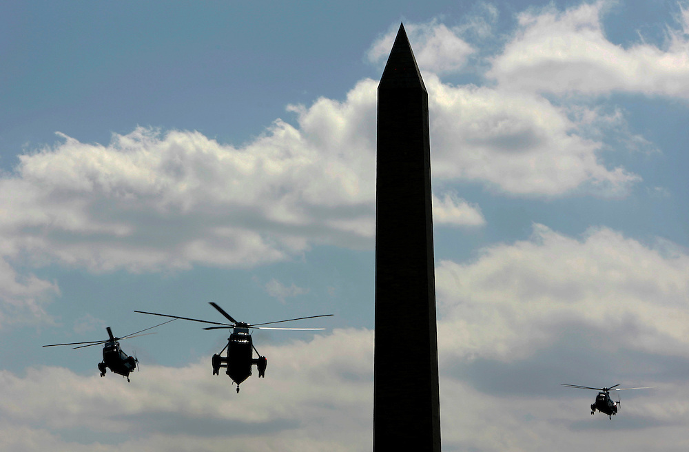 U.S. President George W. Bush and First Lady Laura Bush, aboard Marine One (C), fly past the Washington Monument as they return to the White House in Washington, DC Wednesday 20 September 2006. The President's helicopter is always accompanied by two identical ones in flight.