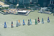 Race start. Day four of the Extreme Sailing Series regatta being sailed in Singapore. 23/2/2014
