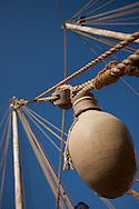 "16th February 2010. Muscat. Oman..Pictures of the clay water pot and mug tied to the rigging of ""The Jewel of Muscat""  shown here leaving her home port of Muscat as they sail and recreate the origanol historic journey to Singapore."
