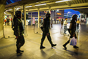 29 MAY 2014 - BANGKOK, THAILAND: Thai soldiers patrol the BTS Skytrain National Stadium station Thursday night. Thousands of Thai soldiers flooded the central parts of Bangkok Thursday to prevent any protests from taking place against the coup that deposed the elected civilian government. For the first time since the coup last week there were no significant protests Thursday.   PHOTO BY JACK KURTZ