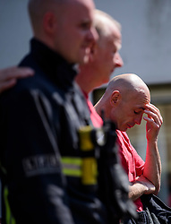 19/06/2017. London, UK. Firefighters who attended the scene of the fire observe minutes silence held near the scene of the Grenfell tower block fire. The blaze engulfed the 27-storey building killing dozens - with 34 people still in hospital, many of whom are in critical condition. Photo credit: Ben Cawthra *** Please Use Credit from Credit Field ***