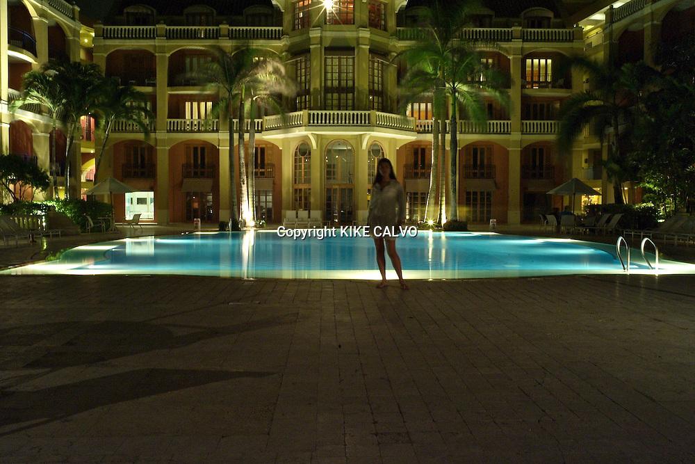 Model released latin woman at the pool. Luxury Sofitel Santa Clara Hotel. Cartagena. Colombia.