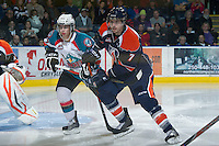 KELOWNA, CANADA - DECEMBER 27:  JT Barnett #17 of the Kelowna Rockets is checked on the ice by Joel Edmundson #7 of the Kamloops Blazers at the Kelowna Rockets on December 27, 2012 at Prospera Place in Kelowna, British Columbia, Canada (Photo by Marissa Baecker/Shoot the Breeze) *** Local Caption ***