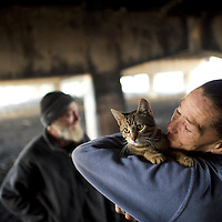 PHILADELPHIA, PA - January 4, 2017.  Judy Wurster, 56, who has been homeless for 3 months, embraces her cat, Sweetpea, in an encampment under Interstate 95 in Philadelphia, PA January 4, 2017.  A nearby sports bar has complained to authorities and made live increasingly difficult.  CREDIT: Mark Makela for The New York Times