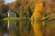 An autumn view of the lake and classical temple at Stourhead Landscape Garden, Stourton, Wiltshire