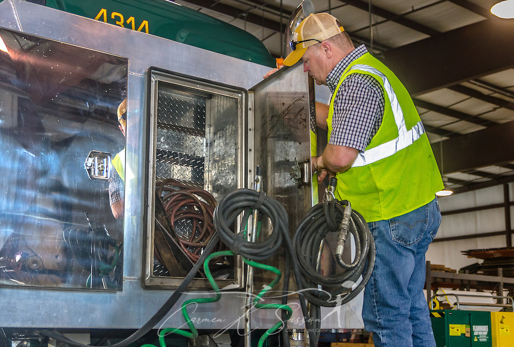 A technician performs routine maintenance on a Mack Pinnacle truck at Superior Transportation, Oct. 2, 2015, in North Charleston, South Carolina. (Photo by Carmen K. Sisson/Cloudybright)