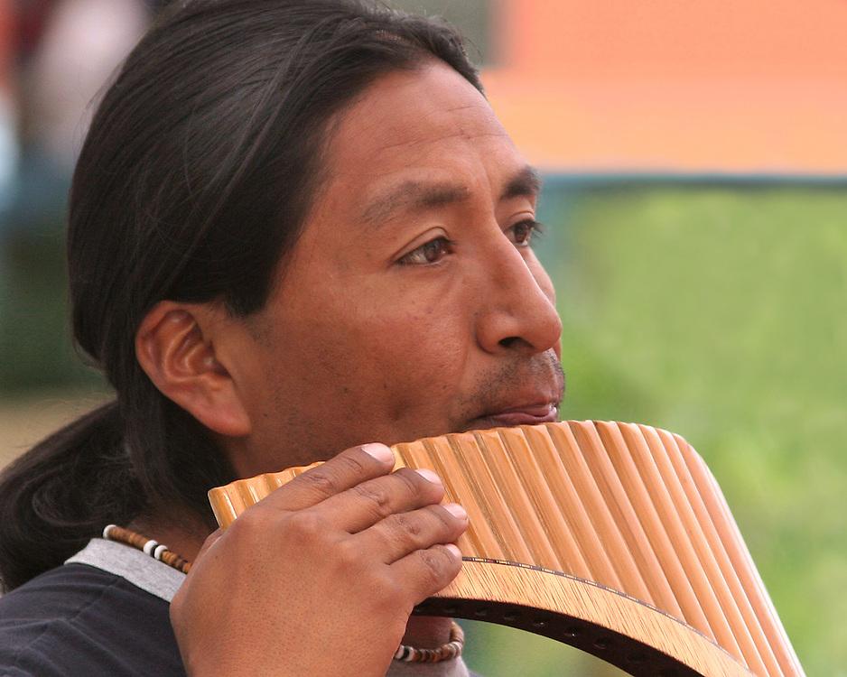 Flutist playing at a street fair.