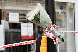 © Licensed to London News Pictures. 22/05/2018. London, UK. Flowers left at the crime scene cordon in Upper Street, Islington with a message which remains closed this morning. Police were called at approximately 18:30hrs on Monday, 21 May to reports of a man suffering stab injuries after being attacked in Upper Street.<br /> Officers and London Ambulance Service attended. The man was pronounced dead at the scene. Photo credit: Vickie Flores/LNP