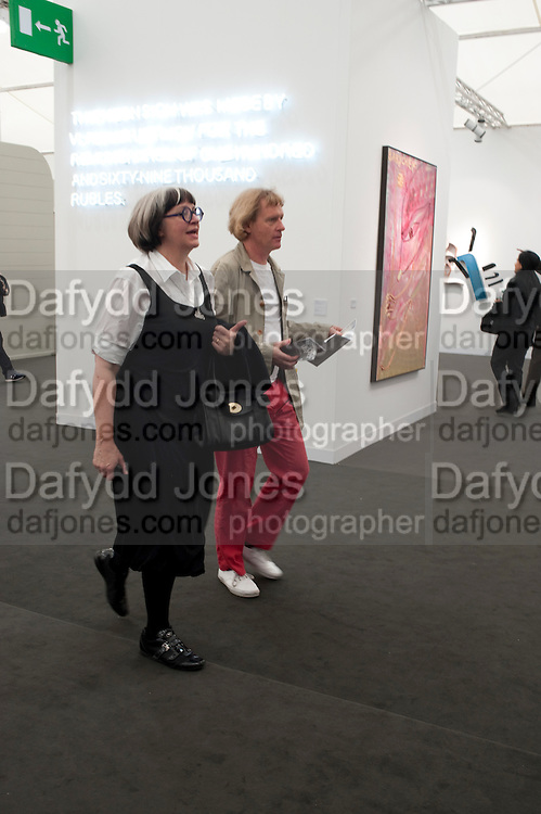 PHILIPPA PERRY; GRAYSON PERRY, OPENING OF FRIEZE ART FAIR. Regent's Park. London.  12 October 2011. <br /> <br />  , -DO NOT ARCHIVE-&copy; Copyright Photograph by Dafydd Jones. 248 Clapham Rd. London SW9 0PZ. Tel 0207 820 0771. www.dafjones.com.