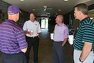 UNI football head coach Mark Farley (from left) and Athletic Director Troy Dannen talk with people during the UNI Panther Prowl at Elmcrest Country Club, 1 Zach Johnson Dr NE, in Cedar Rapids on Monday afternoon, May 7, 2012. (Stephen Mally/Freelance)
