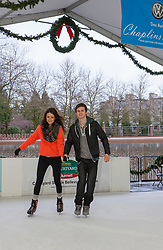 North America, United States, Washington, Bellevue, couple skating in Magic Season Ice Arena, MR, PR