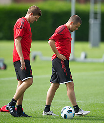 LIVERPOOL, ENGLAND - Wednesday, August 18, 2010: Liverpool's captain Steven Gerrard MBE and Joe Cole during a training session at Melwood ahead of the UEFA Europa League Play-Off 1st Leg match against Trabzonspor A.S. (Pic by: David Rawcliffe/Propaganda)